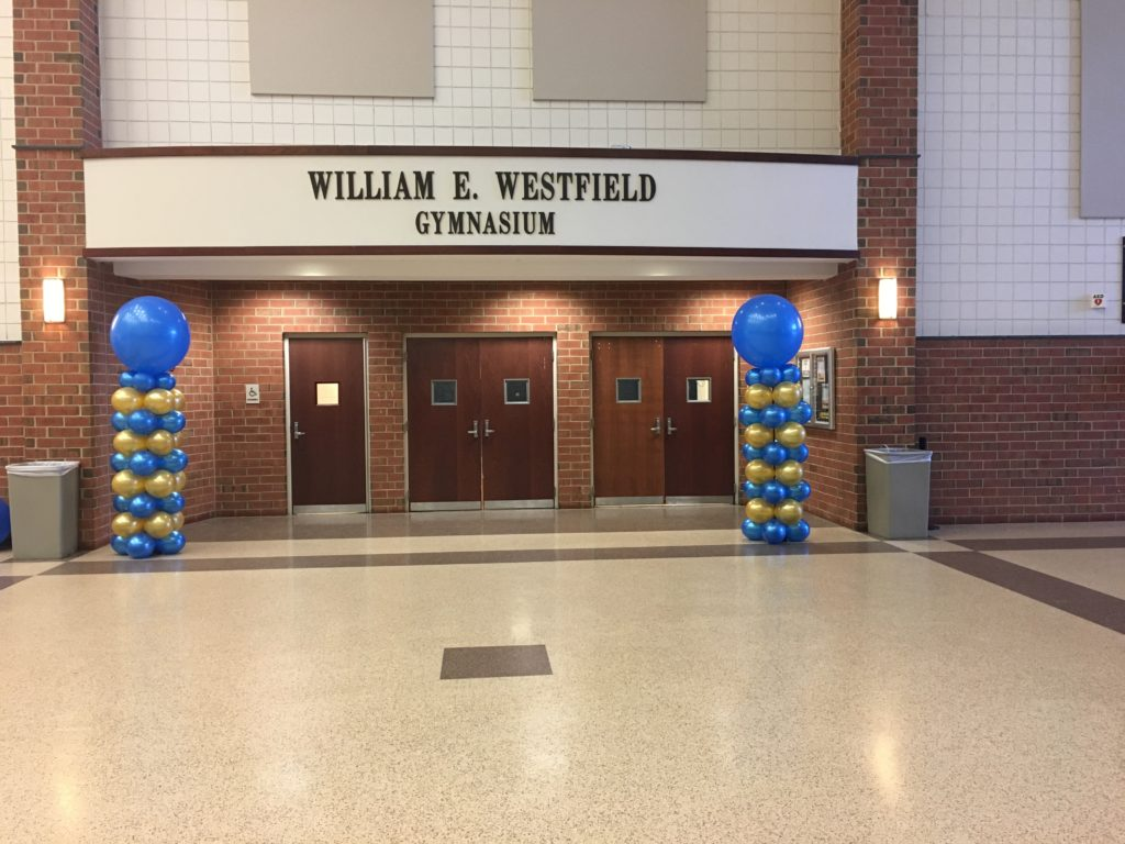 blue and gold balloon columns